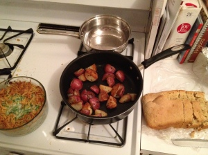 Green bean casserole, rosemary red potatoes, and beer bread. Who says two 24-year-olds can't cook?