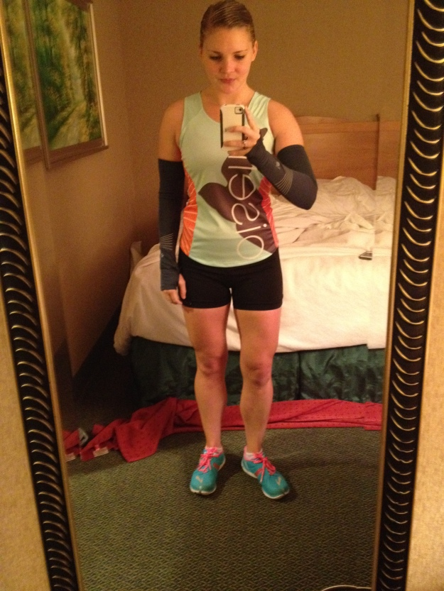 Hotel room selfie. Oiselle jersey, Flyte shorts, arm warmers, and Brooks Pure Connects.