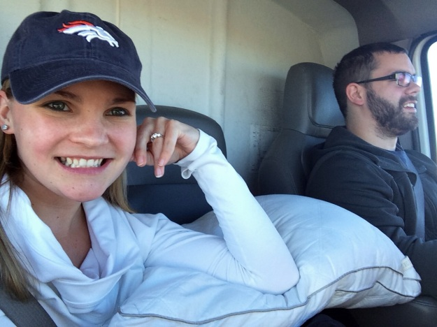Unrelated picture of BF and I in our Uhaul. The cat is in his cage under that pillow. He hated every minute. Also, Broncos.